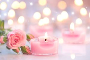 pink candles with a pink rose