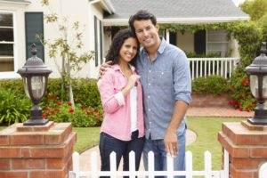 couple_standing_in_front_of_new_home